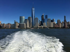 Manhattan skyline with the wake of a ferry in the foreground